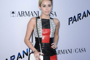 "Miley Cyrus carries a black and white Chanel Boy Bag at the ""Paranoia"" premiere (5)"