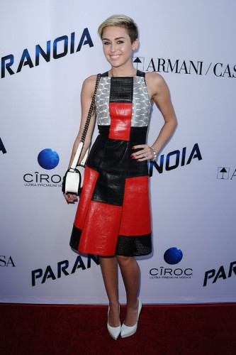 """Miley Cyrus carries a black and white Chanel Boy Bag at the """"Paranoia"""" premiere (3)"""