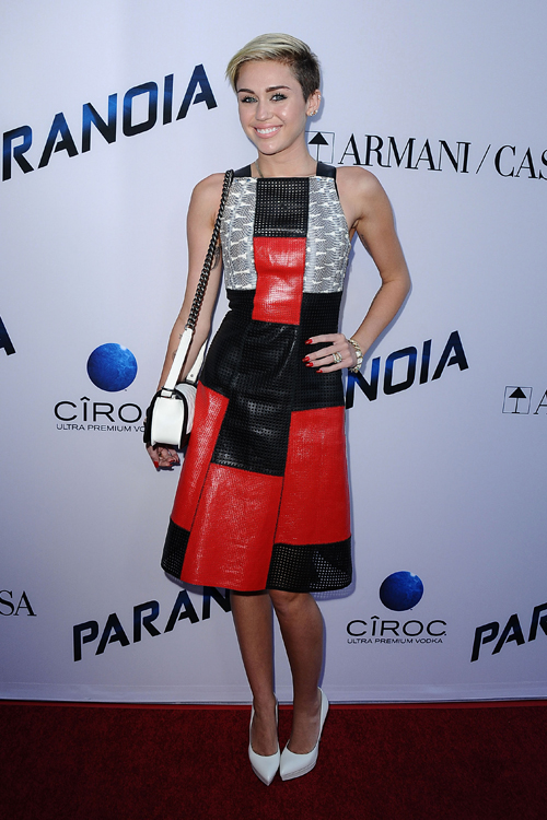 "Miley Cyrus carries a black and white Chanel Boy Bag at the ""Paranoia"" premiere (3)"