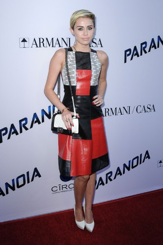 "Miley Cyrus carries a black and white Chanel Boy Bag at the ""Paranoia"" premiere (4)"