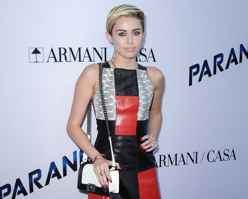 """Miley Cyrus carries a black and white Chanel Boy Bag at the """"Paranoia"""" premiere (5)"""