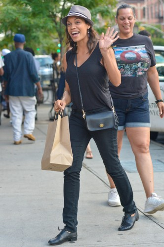 Rosario Dawson carries a Coach Legacy Penny Shoulder Bag in black (2)