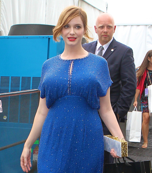 Christina Hendricks leaves New York Fashion Week in a beautiful blue dress
