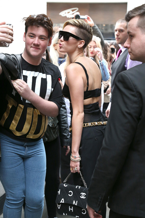 Miley Cyrus carries a Chanel bag in London (2)