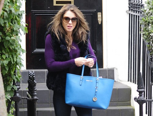 Elizabeth Hurley carries a blue MICHAEL Michael Kors Jet Set Travel Tote (5)