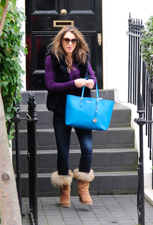 elizabeth hurley goes affordable with a bright michael kors tote rh purseblog com