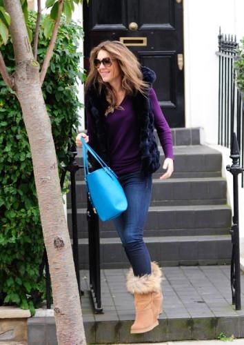 Elizabeth Hurley carries a blue MICHAEL Michael Kors Jet Set Travel Tote (3)