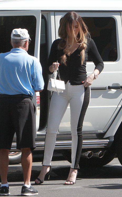 Khloe Kardashian carries a Chanel Lego Mini Flap Bag in California (1)