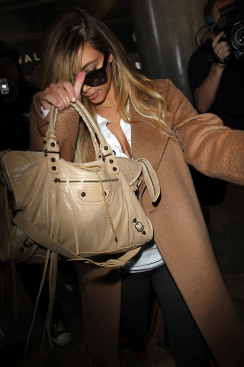 Kim Kardashian carries a beige Balenciaga City Bag (2)