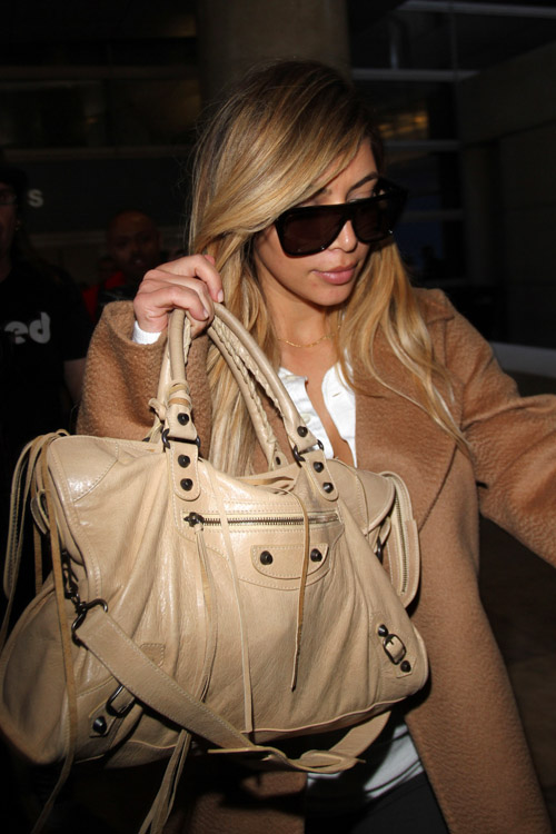 Kim Kardashian carries a beige Balenciaga City Bag (1)