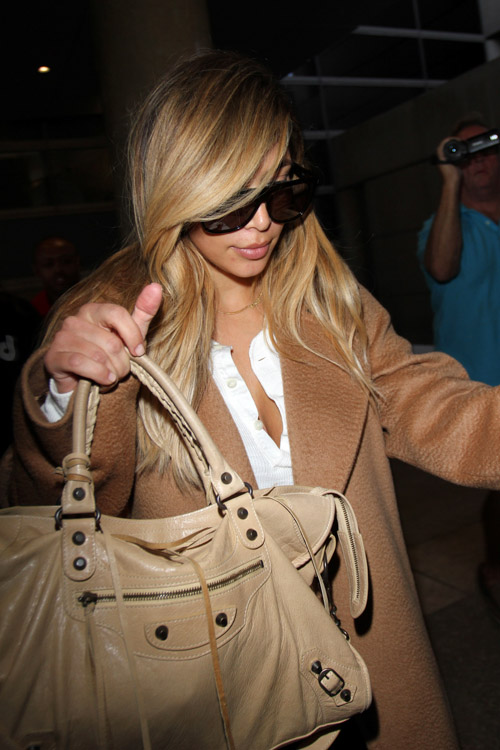 Kim Kardashian carries a beige Balenciaga City Bag (4)
