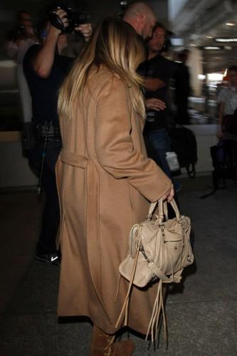 Kim Kardashian carries a beige Balenciaga City Bag (3)
