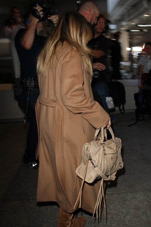 Kim Kardashian carries a beige Balenciaga City Bag (3)