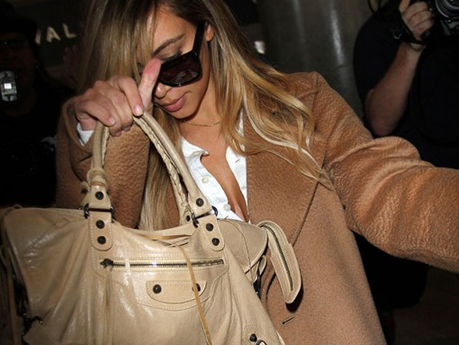 Kim Kardashian carries a beige Balenciaga City Bag (5)