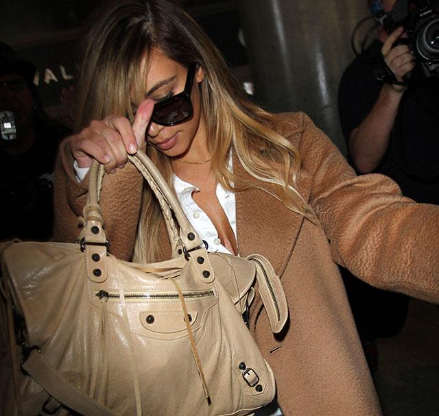 Kim Kardashian Shields Herself with a Balenciaga Bag at the Airport ... 8717e4b941754