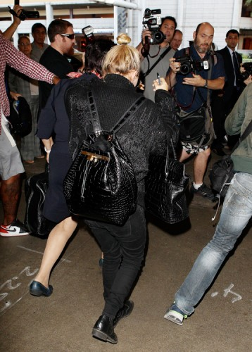 Mary-Kate Olsen carries The Row's Alligator Backpack and The Row's Carry All Tote in Alligator (2)