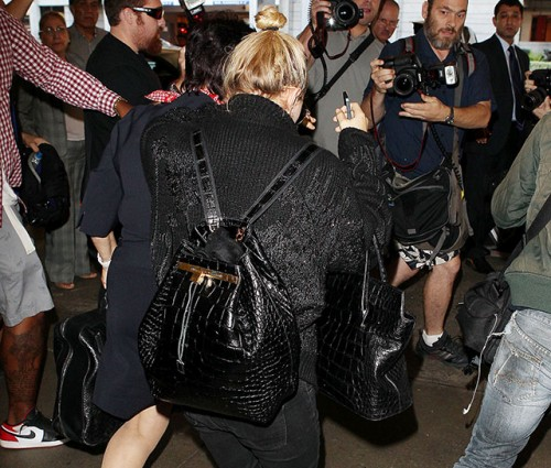 Mary-Kate Olsen carries The Row's Alligator Backpack and The Row's Carry All Tote in Alligator (5)