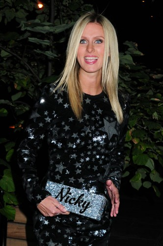 Nicky Hilton carries a customized Edie Parker glitter clutch in NYC (1)