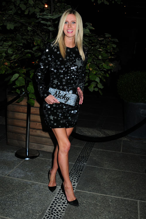 Nicky Hilton carries a customized Edie Parker glitter clutch in NYC (2)