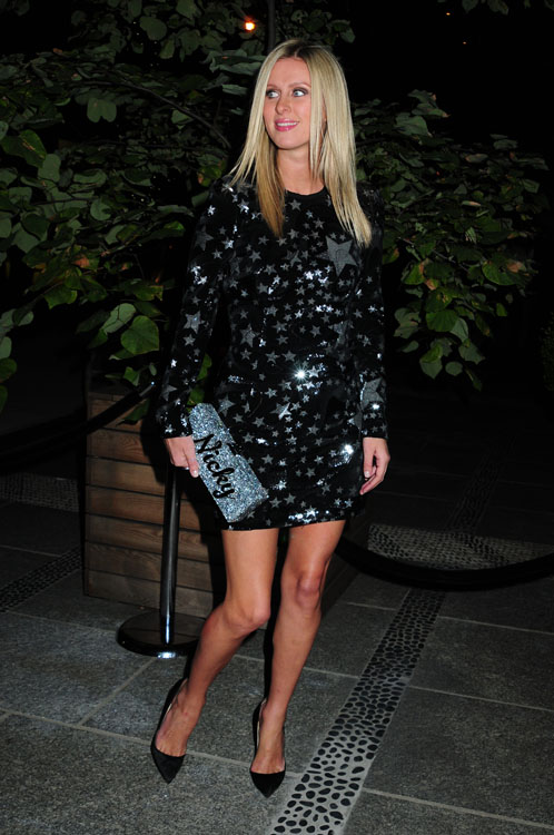 Nicky Hilton carries a customized Edie Parker glitter clutch in NYC (3)
