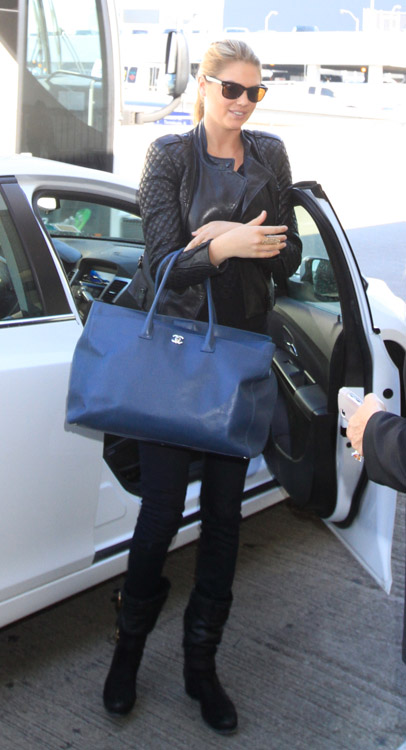kate upton uses a chanel cerf tote as a carry-on