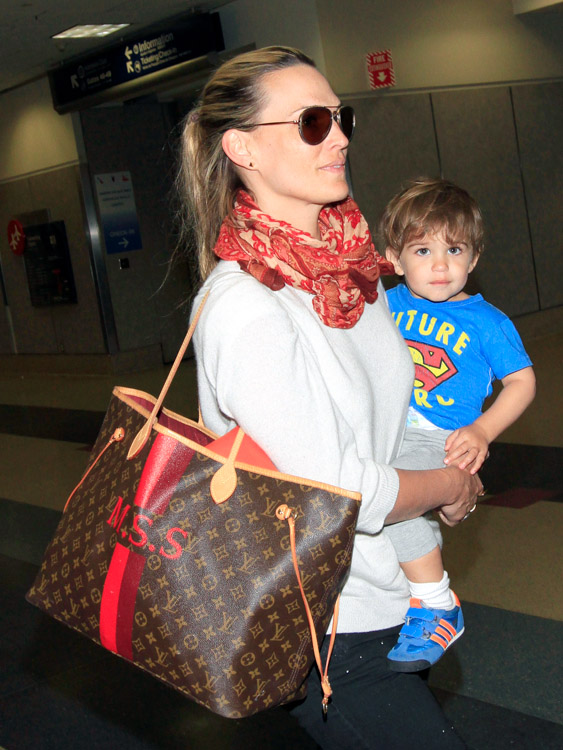 Molly Sims Returns From Vacation With Customized Louis