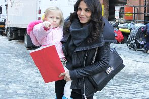 Bethenny Carries Her Daughter and a Christian Louboutin Bag
