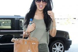 Kimora Lee Simmons Travels with an Hermes Birkin