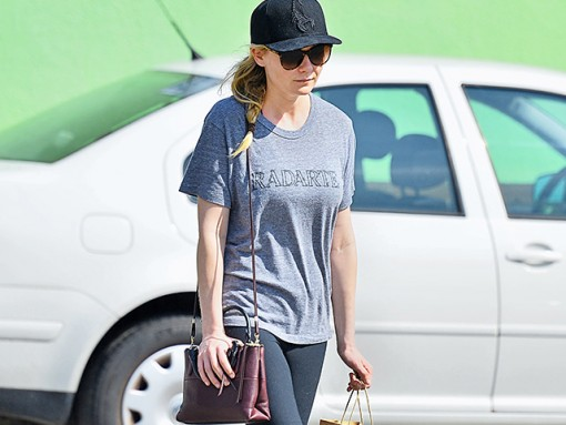 Kirsten Dunst Grabs Lunch with a Coach Bag
