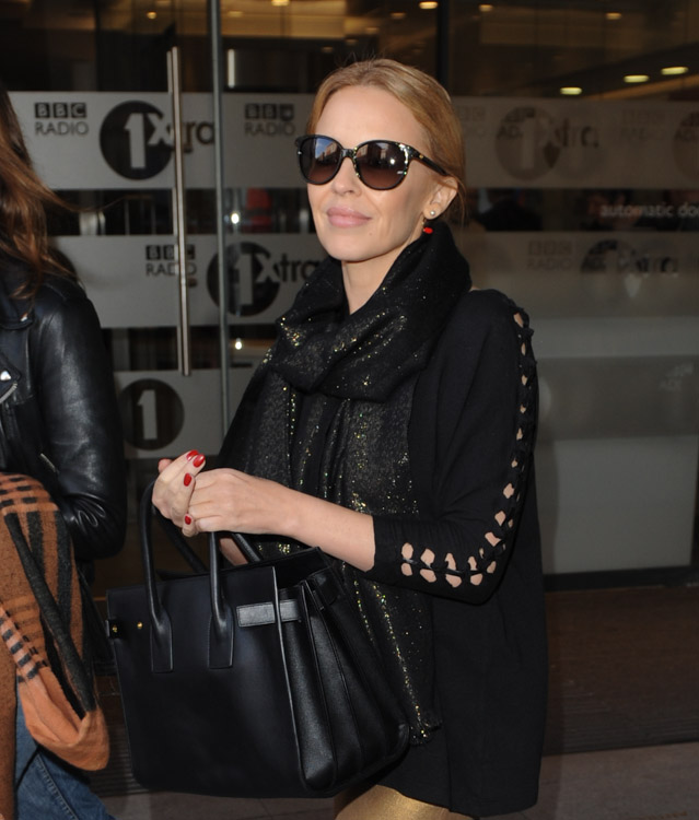 Kylie Minogue Carries Saint Laurent in London