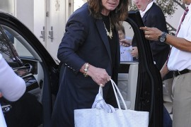Ozzy Osbourne Carries a Goyard Bag for His Wife Sharon