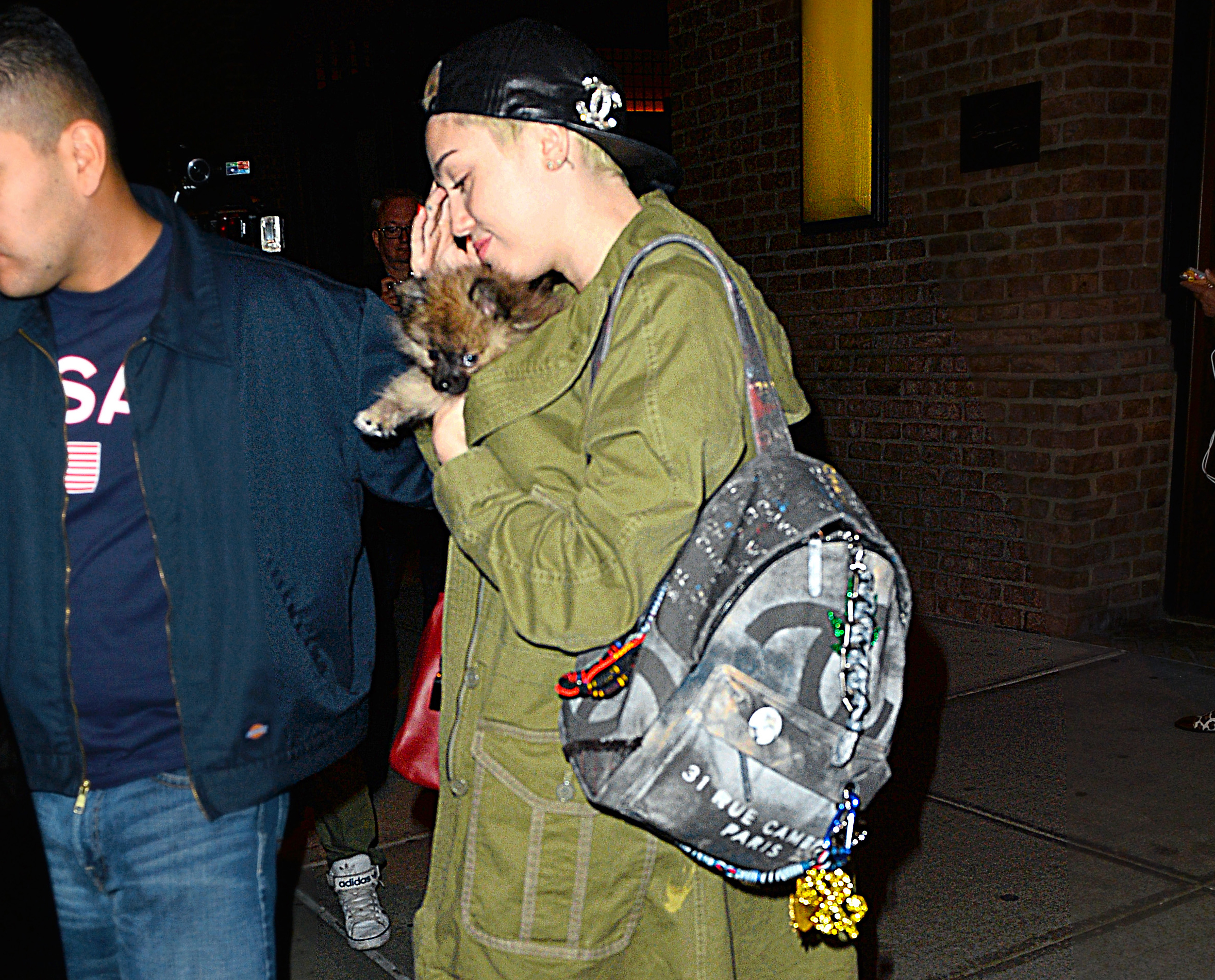 53b00cdd093e Miley Cyrus Carries the Infamous Chanel Graffiti Backpack