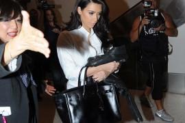 Kim Kardashian Clutches Her Trusty So Black Birkin in a Paparazzi Scrum
