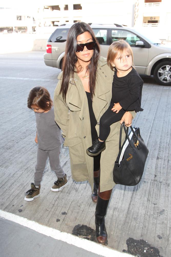 0575f11990df Kourtney Kardashian Carries a Birkin En Route to Kim s Wedding ...