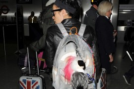 Lily Allen Returns to London with Chanel's Graffiti Backpack