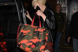 Miley Cyrus is Back and She's Carrying Neon Valentino Camouflage