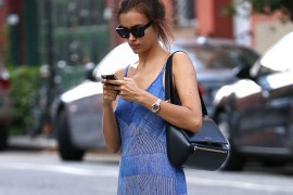 Irina Shayk Texts While Crossing the Street, Endangering Her Givenchy Bag