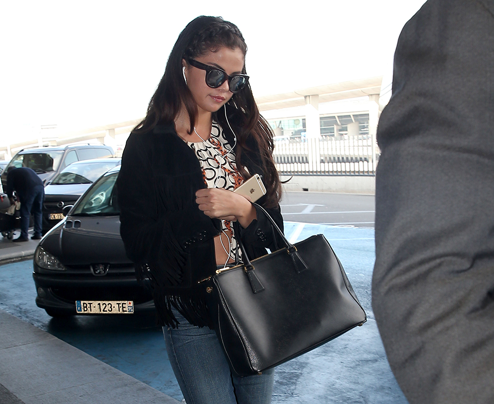 b453ec06 Selena Gomez Escapes Paris Fashion Week with a Prada Tote in Hand ...