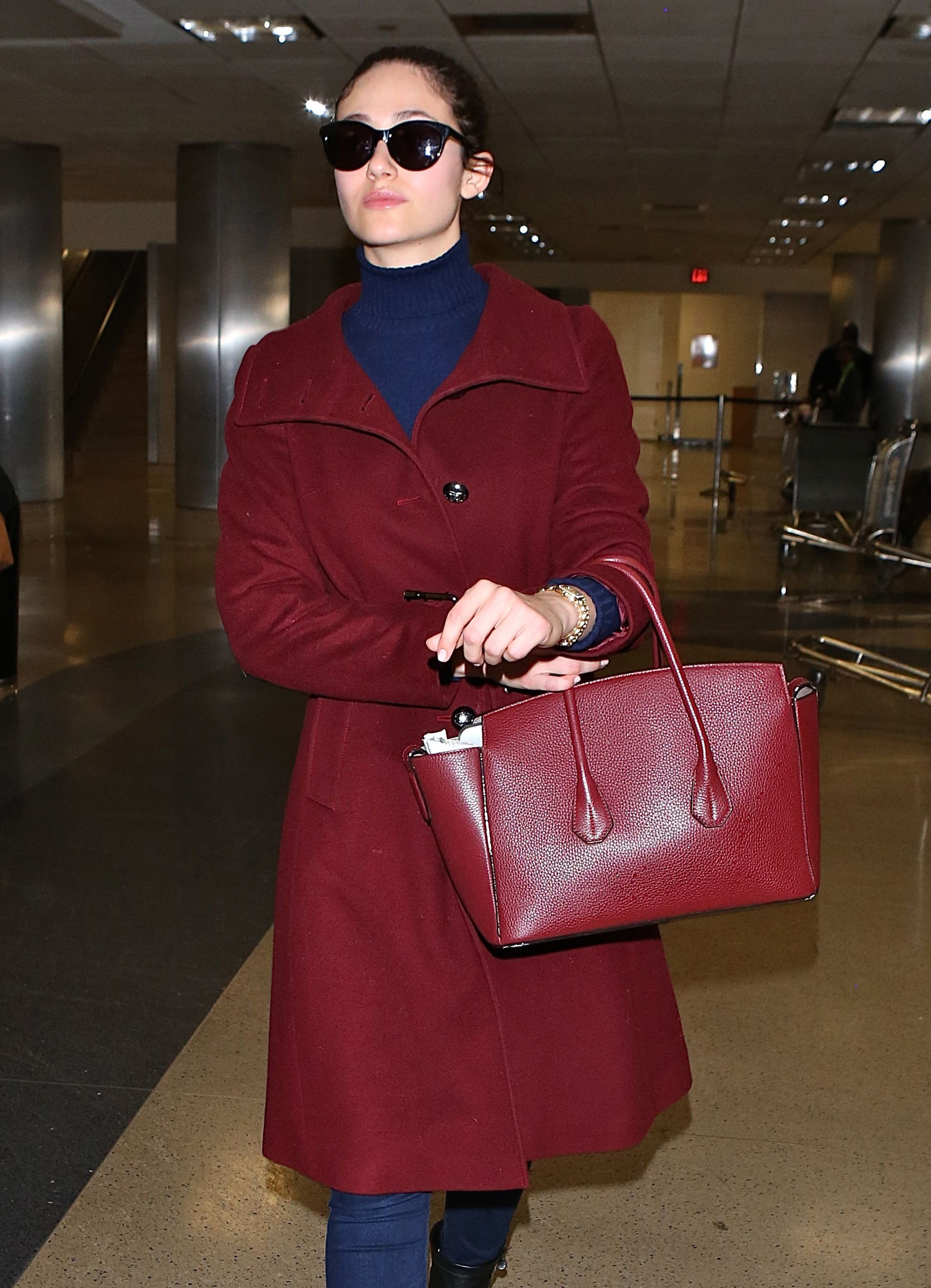 Emmy Rossum looks elegant as she arrives in Los Angeles at LAX
