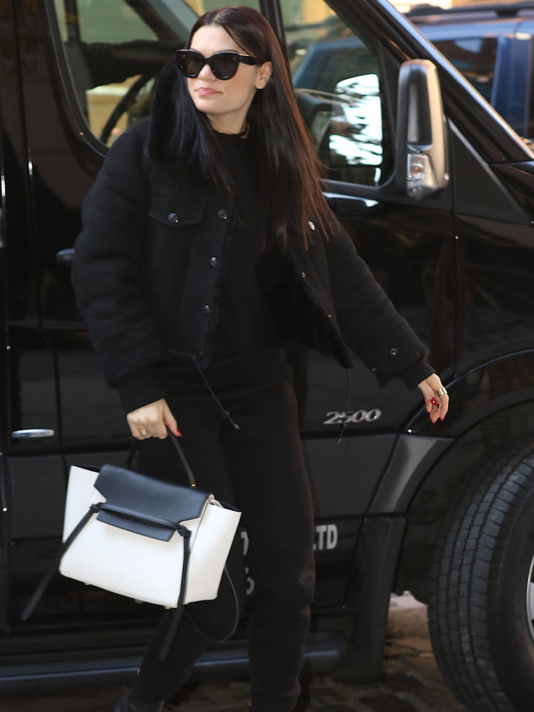 Jessie J is cheerful in all black as she returns to her SoHo hotel this afternoon