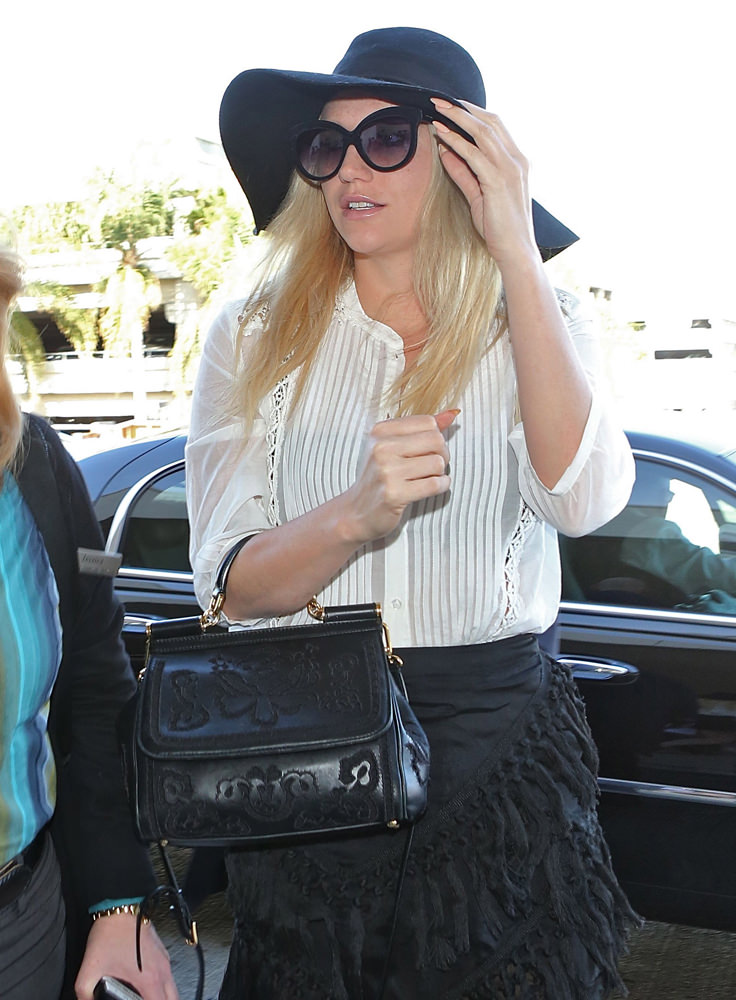 Kesha departs from Los Angeles at LAX