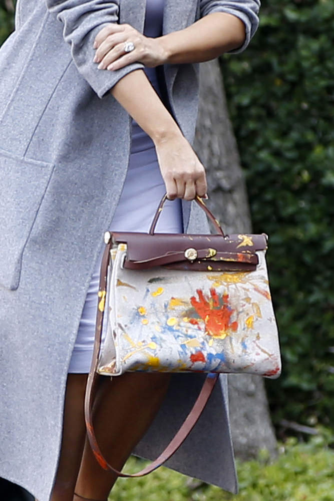 kim kardashian debuts herm232s bag painted by baby north