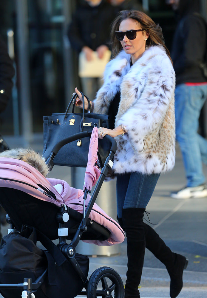 Jay Rutland and Tamara Ecclestone take a walk in Central Park with baby Sophia in a stroller in NYC