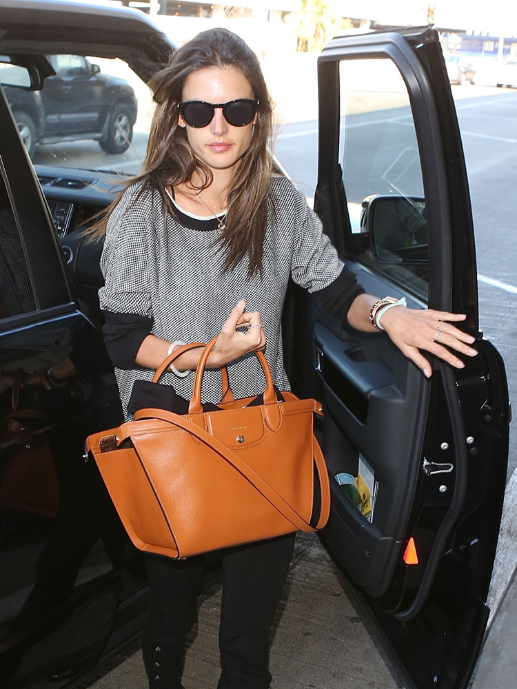 Alessandra Ambrosio departs LAX with her husband in Los Angeles