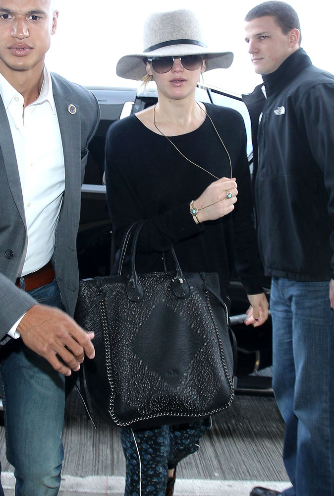 Jennifer Lawrence arrives at the Los Angeles International Airport **NO DAILY MAIL SALES**