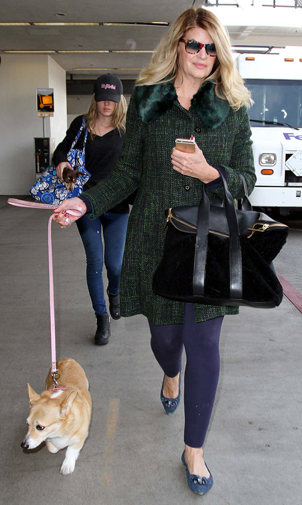 Actress Kirstie Alley is spotted with her dogs as she arrives at LAX Airport in Los Angeles