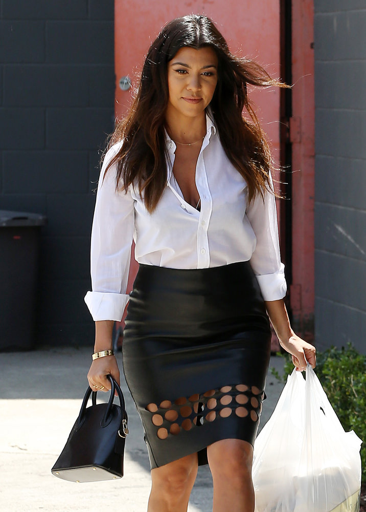 Kim Kardashian and Kourtney Kardashian shopping at an antique store with Scott Disick