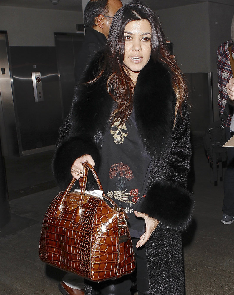 Khloe and Kourtney Kardashian were seen arriving on a flight at LAX