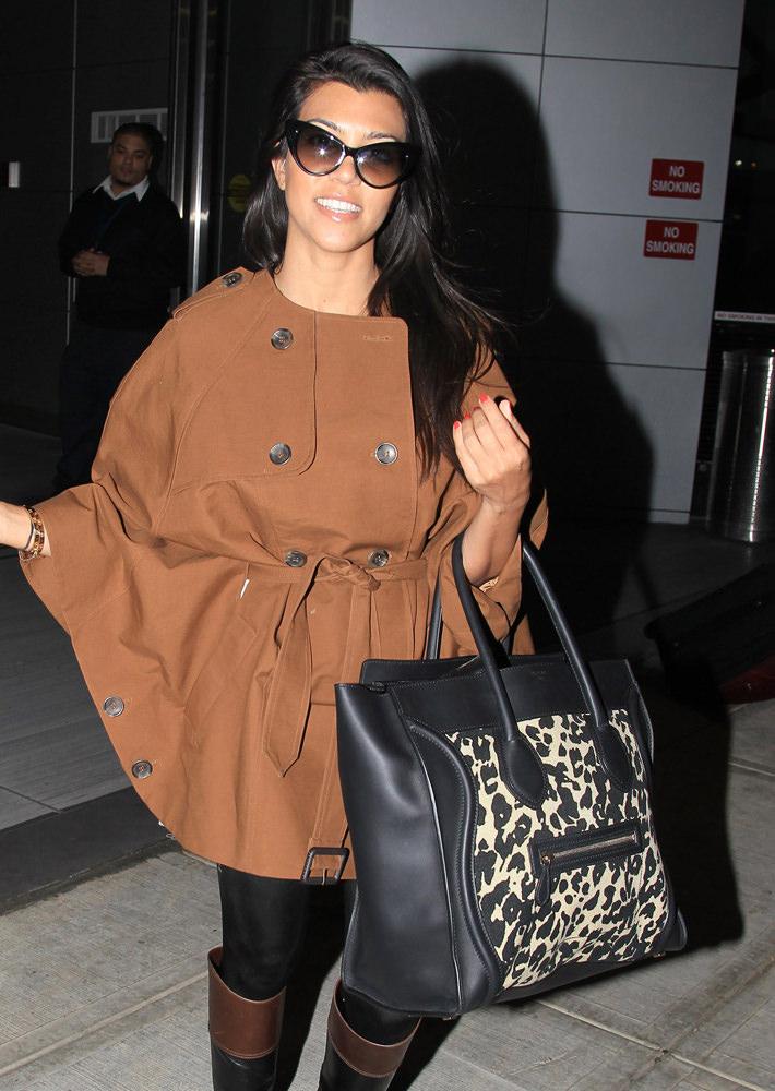 21a623fa228d Kourtney Kardashian and sister Khloe Kardashian touch ground at JFK airport  in New York.