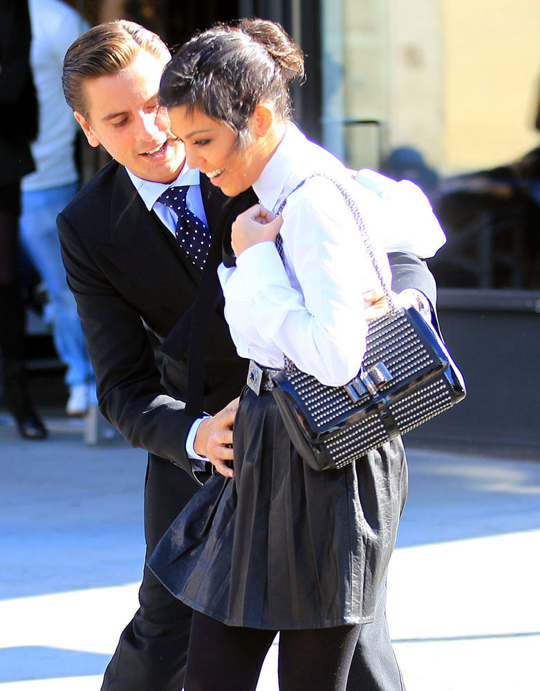 Scott Disick sweeps Kourtney Kardashian off her feet during a romantic walk in the Meatpacking District in NYC